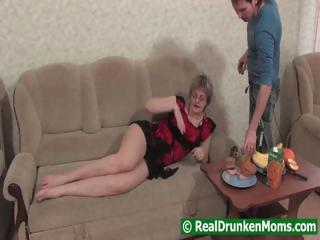Drunk mom with a younger lad starts to fuck and then passes out
